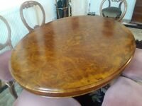 Victorian walnut oval dining table with six Victorian walnut chairs