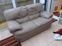 Leather sofa beige. Good quality. Heavy. Good condition. Showing minor signs of wear.