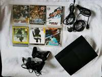 Ps3 with 6 games 2 controllers