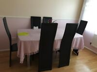 Glass dinning table with 6 leather chairs