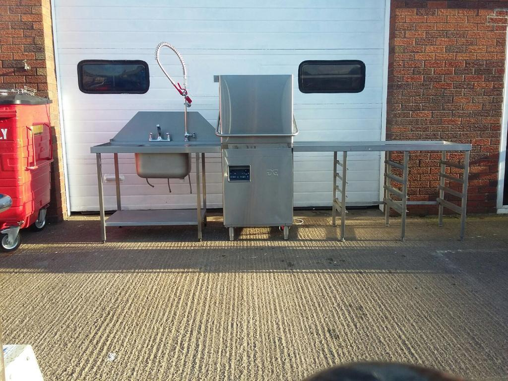D C commercial pass through dishwasher sink with spray wand and drying table
