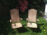 Pair of folding garden chairs - rattan with cast iron frames
