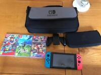 Nintendo switch neon red/blue with all accessories and best games.