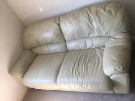 1 two seater and 1 three seater cream leather sofas