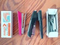 Two staplers and several hundred staples