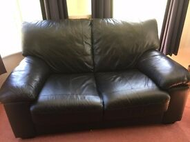 2-piece black leatherette suite (2-seater sofa and armchair), good condition
