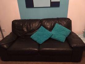 Dark leather effect sofa