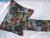 BOLSTER CUSHION AND 18X18 CUSHION IN A HEAVY MACHETE FABRIC COVERED IN PRINTS OF DOGS