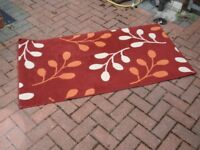 Red / Rust Coloured Rug with Leaf Pattern