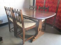 ERCOL DARK OAK REFECTORY DINING TABLE WITH FOUR MATCHING DINING CHAIRS WITH SEAT PADS FREE DELIVERY