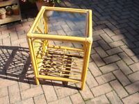 cane coffee table with glass top and shelf