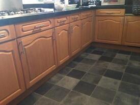 Kitchen cupboards, oven, hob, fridge/freezer, extractor fan