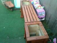 Wooden seat with 2 planters either side