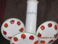 Tin bread bin ,spaghetti container and 3 plates