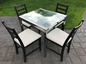 Glass table and chairs. Very good condition!