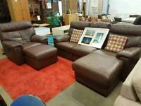 Large brown corner sofa with electric recliner chair and footstool