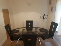 Black double layer glass dining table and chairs (place mats and coasters included)