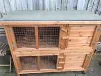Rabbit hutch 2 tier also a cover for the hutch and a rabbit carrier.