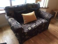 Two Piece - Two seater sofa and an arm chair
