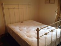 White, metal framed double bed with mattress