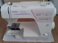 Toyota SA63 electric sewing machine with accessories.