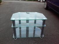 CLEAR GLASS TV STAND WITH GREY LEGS