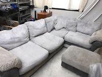L shaped corner sofa in light grey.