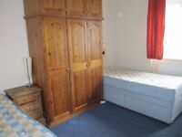 Large furnished twin room in shared house