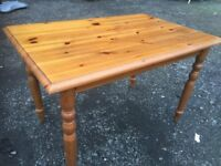 Solid pine dining table in good solid and sturdy condition