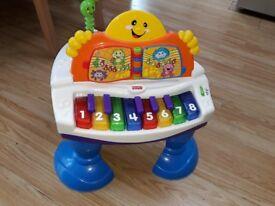 Fisher price baby grand piano