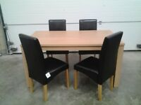Ex display Excellent table and 4 chairs in black faux. Bargain Can deliver.