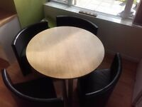 Round Hideaway table and four chairs