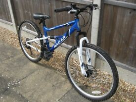 Dual suspension 18 speed Blue Mountain Bike in excellent condition and working order
