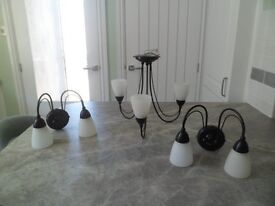 3 shade black ceiling light and a pair of matching wall lights with frosted glass shades