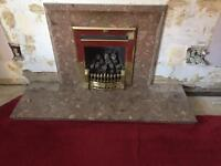Gas fire with marble surround and hearth.