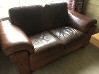 2 seater brown leather sofa made by natuzzi