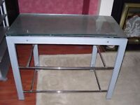 TELEVISION TABLE/STAND,GREY METAL AND GLASS.