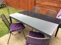 Glass top outdoor table and 4 chairs