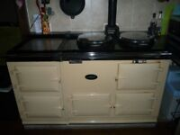 A 4 door, cream, oil powered Aga in great working condition.