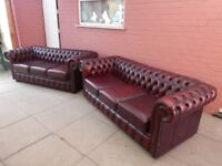 A Pair Of Oxblood Red Leather Chesterfield Three Seater Sofas