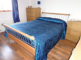 DOUBLE BED, VERY GOOD QUALITY. WOOD AND METAL SLEIGH DESIGN.