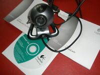 Logiteck web cam and accessories includes disc and instructions booklet. Clear images