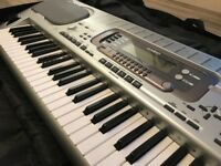 Casio WK-3500 electronic keyboard and carry case