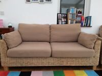 Two seater sofa and armchair in good condition, would suit conservatory or garden room.