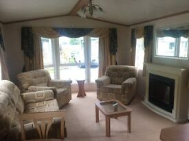 DOUBLE GLAZED AND CENTRAL HEATED QUALITY STATIC CARAVAN FOR SALE ON 12 MONTH SEASON PARK WOOLER