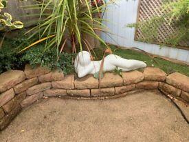White Naked lady garden statue.