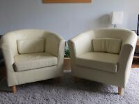 Pair of Ikea TULLSTA tub chairs in cream leather