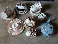 1 teapot and 5 designs of cups, saucers and plates - 20 settings in all