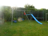 Climbing frame, slide and swings