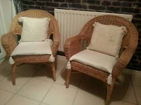 Pair of solid rattan chairs ex condition